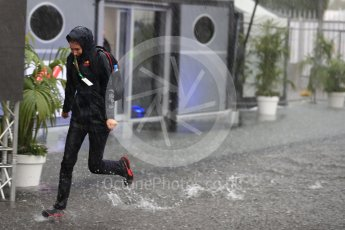 World © Octane Photographic Ltd. Formula 1 – Italian GP - Paddock. Red Bull crew running through the puddles Autodromo Nazionale di Monza, Monza, Italy. Friday 31st August 2018.