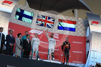 World © Octane Photographic Ltd. Formula 1 – Japanese GP – Podium. Mercedes AMG Petronas Motorsport AMG F1 W09 EQ Power+ - Lewis Hamilton and Valtteri Bottas and Aston Martin Red Bull Racing TAG Heuer RB14 – Max Verstappen. Suzuka Circuit, Japan. Sunday 7th October 2018.