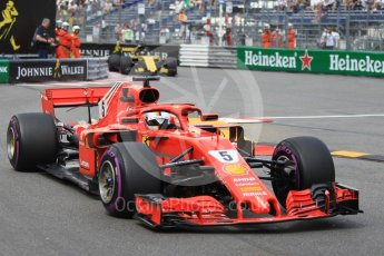 World © Octane Photographic Ltd. Formula 1 – Monaco GP - Practice 2. Scuderia Ferrari SF71-H – Sebastian Vettel and Renault Sport F1 Team RS18 – Nico Hulkenberg. Monte-Carlo. Thursday 24th May 2018.
