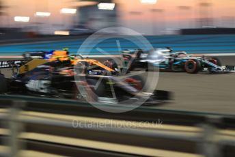 World © Octane Photographic Ltd. Formula 1 – Abu Dhabi GP - Practice 2. Haas F1 Team VF19 – Kevin Magnussen, McLaren MCL34 – Lando Norris and Mercedes AMG Petronas Motorsport AMG F1 W10 EQ Power+ - Lewis Hamilton. Yas Marina Circuit, Abu Dhabi, UAE. Friday 29th November 2019.