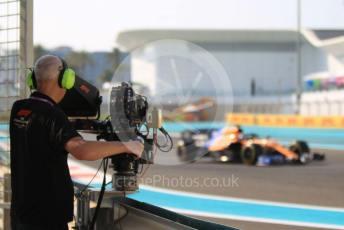 World © Octane Photographic Ltd. Formula 1 – Abu Dhabi GP - Practice 3. McLaren MCL34 – Carlos Sainz and trackside TV camera. Yas Marina Circuit, Abu Dhabi, UAE. Saturday 30th November 2019.