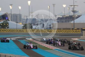 World © Octane Photographic Ltd. Formula 1 – Abu Dhabi GP - Race. SportPesa Racing Point RP19 - Sergio Perez and Scuderia Toro Rosso STR14 – Pierre Gasly (with missing front wing) run wide through turn1. Yas Marina Circuit, Abu Dhabi, UAE. Sunday 1st December 2019.