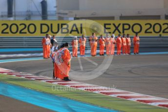 World © Octane Photographic Ltd. Formula 1 - Abu Dhabi GP - Race. Race marshals at turn 1. Yas Marina Circuit, Abu Dhabi, UAE. Sunday 1st December 2019.