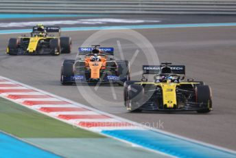 World © Octane Photographic Ltd. Formula 1 – Abu Dhabi GP - Race. Renault Sport F1 Team RS19 – Daniel Ricciardo and Nico Hulkenberg sandwiching the  McLaren MCL34 of Carlos Sainz. Yas Marina Circuit, Abu Dhabi, UAE. Sunday 1st December 2019.