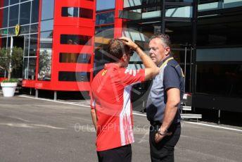 World © Octane Photographic Ltd. Formula 1 – Austrian GP - Paddock. Scuderia Ferrari SF90 – Sebastian Vettel chats with Mario Isola – Pirelli Head of Car Racing . Red Bull Ring, Spielberg, Styria, Austria. Thursday 27th June 2019.