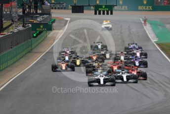 World © Octane Photographic Ltd. Formula 1 – British GP - Race. Mercedes AMG Petronas Motorsport AMG F1 W10 EQ Power+ - Valtteri Bottas leads the race start. Silverstone Circuit, Towcester, Northamptonshire. Sunday 14th July 2019.