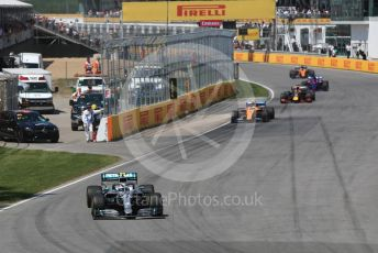 World © Octane Photographic Ltd. Formula 1 – Canadian GP. Race. Mercedes AMG Petronas Motorsport AMG F1 W10 EQ Power+ - Valtteri Bottas, McLaren MCL34 – Lando Norris, Aston Martin Red Bull Racing RB15 – Max Verstappen, Scuderia Toro Rosso STR14 – Daniil Kvyat and Lando Norris. Circuit de Gilles Villeneuve, Montreal, Canada. Sunday 9th June 2019.