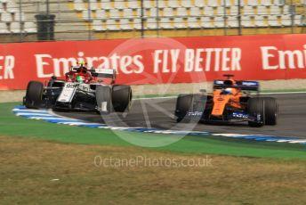 World © Octane Photographic Ltd. Formula 1 – German GP - Practice 1. McLaren MCL34 – Carlos Sainz and Alfa Romeo Racing C38 – Antonio Giovinazzi. Hockenheimring, Hockenheim, Germany. Friday 26th July 2019.
