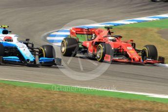 World © Octane Photographic Ltd. Formula 1 – German GP - Practice 2. Scuderia Ferrari SF90 – Sebastian Vettel and ROKiT Williams Racing FW42 – Robert Kubica. Hockenheimring, Hockenheim, Germany. Friday 26th July 2019.
