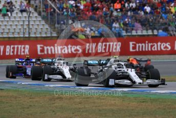 World © Octane Photographic Ltd. Formula 1 – German GP - Race. Mercedes AMG Petronas Motorsport AMG F1 W10 EQ Power+ - Valtteri Bottas and Lewis Hamilton with Scuderia Toro Rosso STR14 – Alexander Albon. Hockenheimring, Hockenheim, Germany. Sunday 28th July 2019.