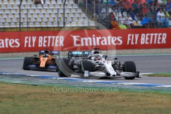 World © Octane Photographic Ltd. Formula 1 – German GP - Race. Mercedes AMG Petronas Motorsport AMG F1 W10 EQ Power+ - Lewis Hamilton and McLaren MCL34 – Carlos Sainz. Hockenheimring, Hockenheim, Germany. Sunday 28th July 2019.