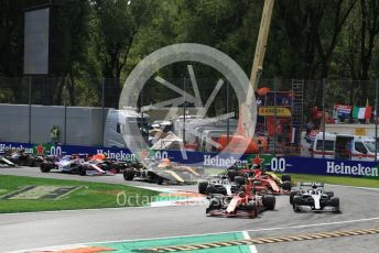 World © Octane Photographic Ltd. Formula 1 – Italian GP - Race. Scuderia Ferrari SF90 – Charles Leclerc and Mercedes AMG Petronas Motorsport AMG F1 W10 EQ Power+ - Valtteri Bottas leads into turn 1. Autodromo Nazionale Monza, Monza, Italy. Sunday 8th September 2019.