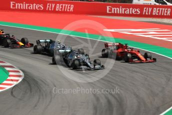 World © Octane Photographic Ltd. Formula 1 – Spanish GP. Race. Mercedes AMG Petronas Motorsport AMG F1 W10 EQ Power+ - Lewis Hamilton and Valtteri Bottas and Scuderia Ferrari SF90 – Sebastian Vettel. Circuit de Barcelona Catalunya, Spain. Sunday 12th May 2019.