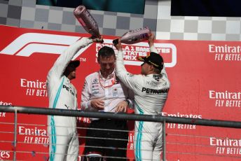 World © Octane Photographic Ltd. Formula 1 – United States GP - Podium. Mercedes AMG Petronas Motorsport AMG F1 W10 EQ Power+ - Valtteri Bottas, Lewis Hamilton and Technical Director James Allison. Circuit of the Americas (COTA), Austin, Texas, USA. Sunday 3rd November 2019.
