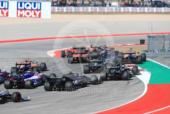 World © Octane Photographic Ltd. Formula 1 – United States GP - Race. Mercedes AMG Petronas Motorsport AMG F1 W10 EQ Power+ - Valtteri Bottas leads the pack as McLaren MCL34 – Carlos Sainz runs wide. Circuit of the Americas (COTA), Austin, Texas, USA. Sunday 3rd November 2019.