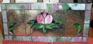 Jackie's Glassworks offers handmade stained glass creations and more.