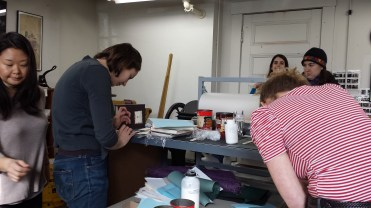Finishing up title cards on our books. Many thanks to Cody (in the back) for teaching!