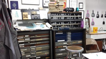 Cases of lead type at Bow & Arrow Press.