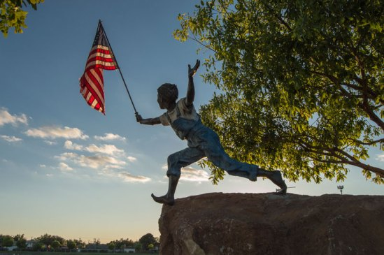Boy with American Flag - Christina Hanes