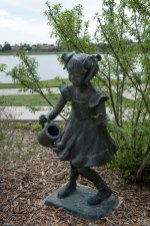 Small Girl with Pigtails and Watering Can