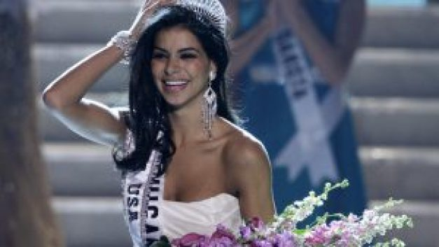 Miss Michigan Rima Fakih reacts after being crowned Miss USA during the 2010 Miss USA pageant in Las Vegas