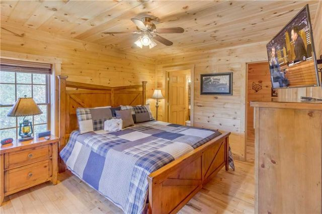 Late-night viewing - This master bedroom on the bottom floor has a separate, enclosed sleeping area with bunk beds. Both of these spaces share a bathroom, making this suite ideal for a family with kids in your group.