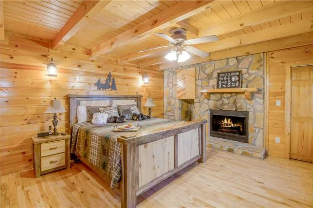 A room for all seasons - In winter the fireplace of the main floor�??s master suite will cast a warm, romantic glow over the wood-planked walls and beamed ceiling; in summer the ceiling fan will lull you to sleep with its gentle breeze.