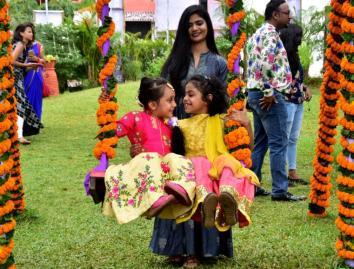 Two small girl enjoying Raja Festival at OTDC in Bhubaneswar on Thursday..