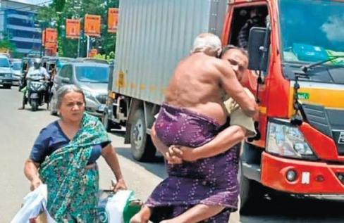 Kerala man carry his father to hospital