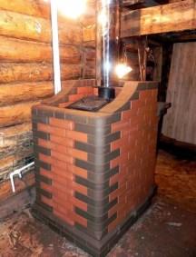 Металлическая печь красиво обложенная кирпичом