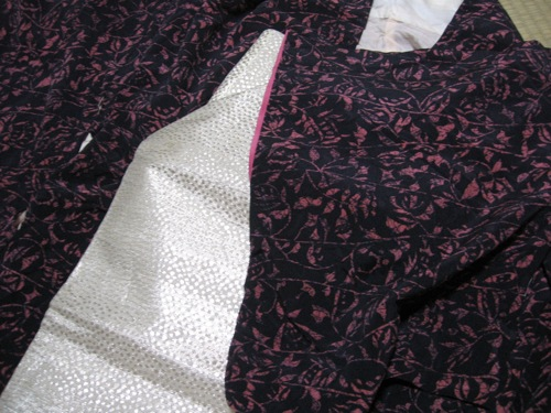 Two of my many treasures from Kyoto: my black-and-pink kimono and my gold obi