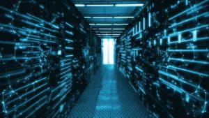 Sala centrum danych z abstrakcyjnymi serwerami danych i swiecacymi wskaznikami led