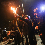 [VIDEO] Protesters Fight Off Police With Fire, Arrows