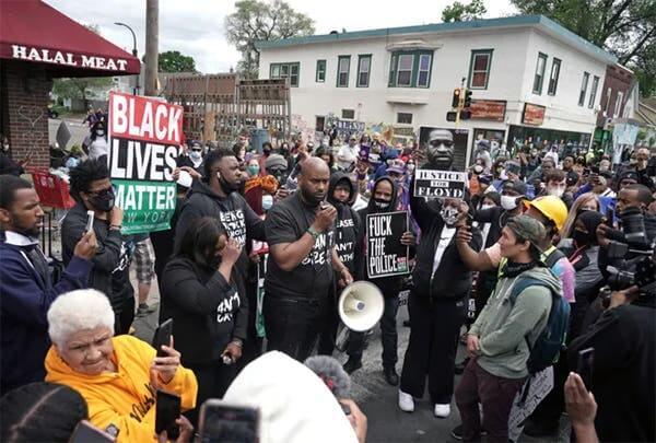 Demonstrators protest the killing of George Floyd