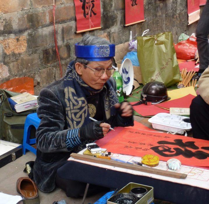 dozens of calligraphers showcasing their talent