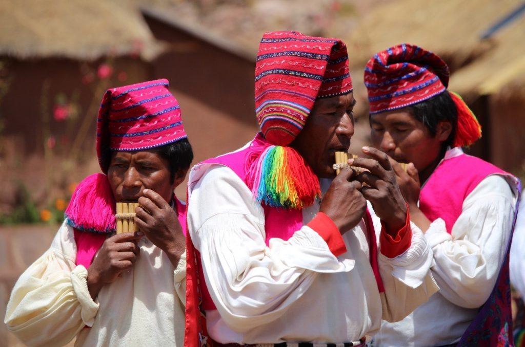playing their pan flutes