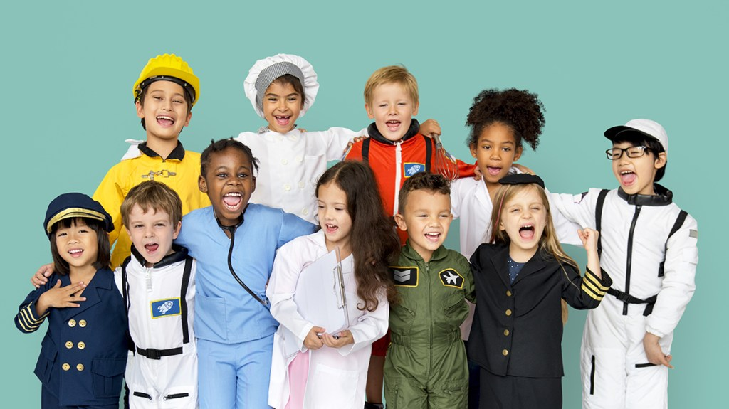 Young children dressed up as what they want to be when they grow up, such as nurse, chef, astronaut and police officer