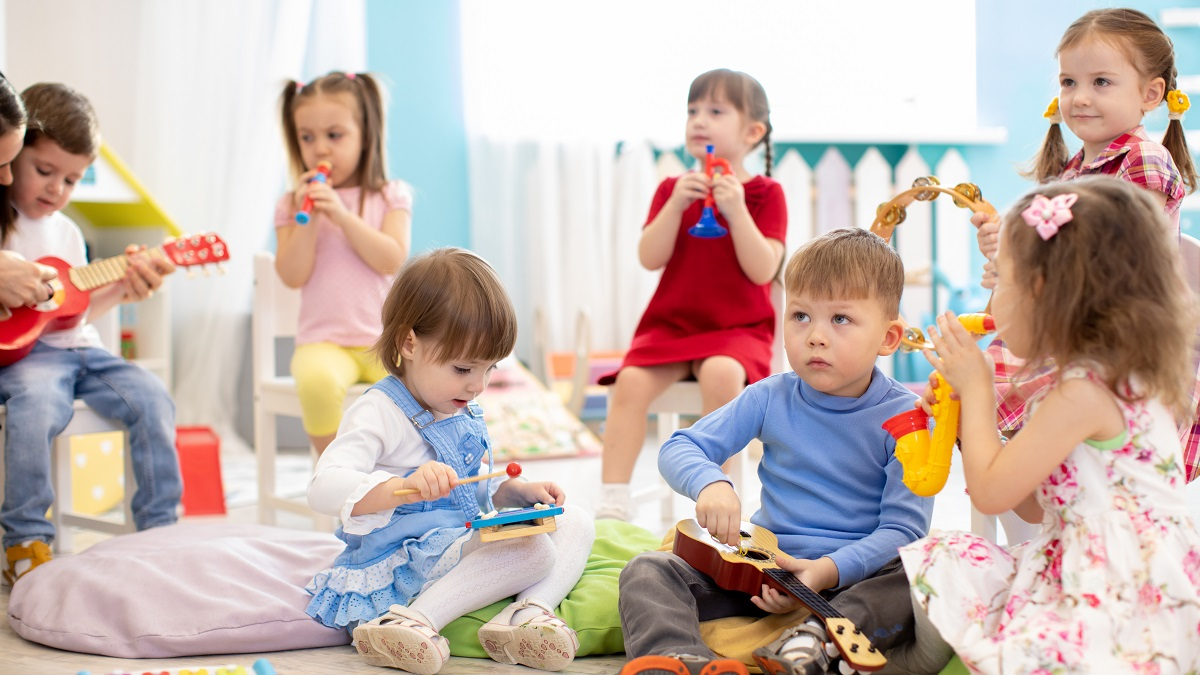 Young children sitting and playing with toys in an early childhood education and care centre
