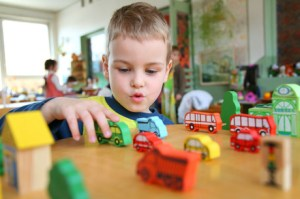 boy-playing-with-wooden-buses0154-460x306