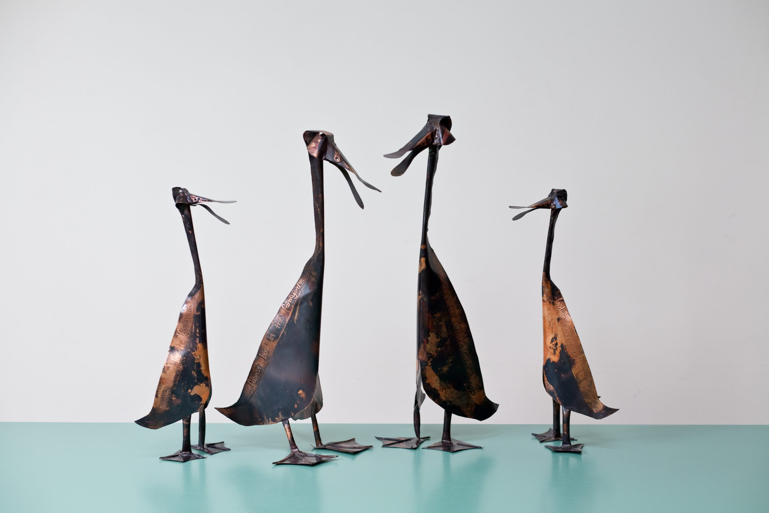 copper etched indian runner duck sculptures