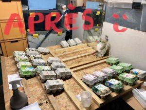 table de stockage en partie vidée de ses boites d'oeufs
