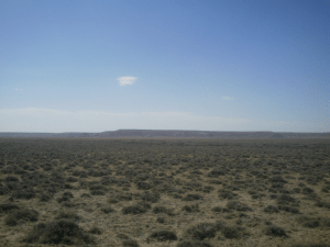 Sagebrush covers the Red Desert in Wyoming, with the Honeycomb Buttes to the south and west
