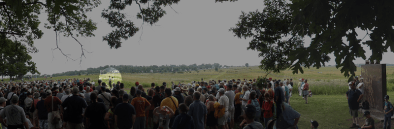1000 odd visitors listen to the rangers (highlight) on Seminary Ridge, resting after their march in column from the Emmitsburg Pike.  The March of the Iron Brigade battlefield experience, 150th anniversary of Gettysburg.