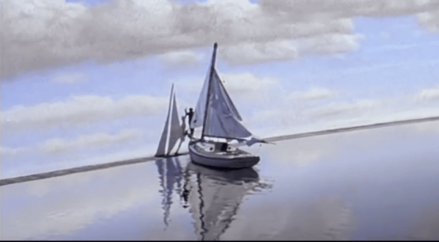 Still from the Truman Show film, showing Truman sailing until he reaches the edge of the TV studio