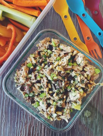 Chicken salad with livers packed for a picnic with sliced veggies