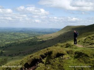 A walker on Hay Bluff, the Black Mountains landmark