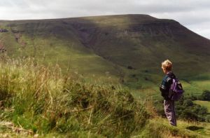 Tom, who walked the southern half of the Path aged 6, in front of the distinctive outline of Hay Bluff.