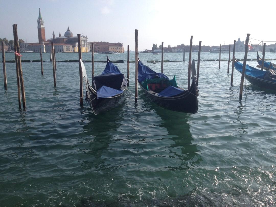Gondolas in canal in Venice