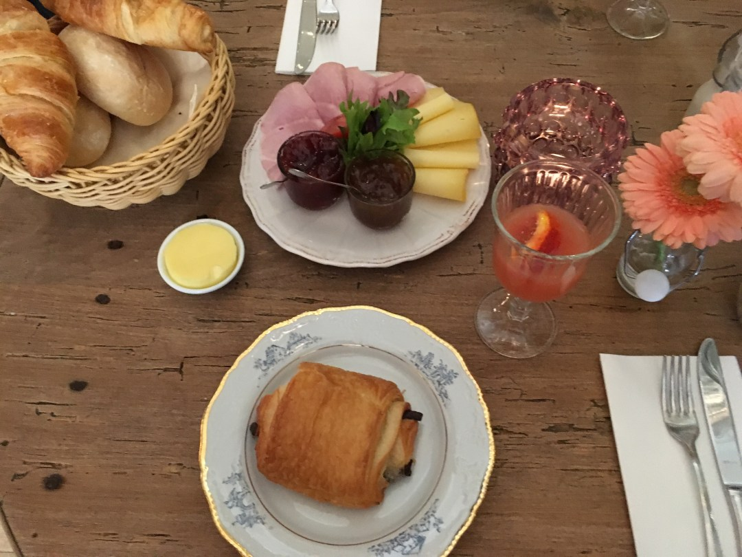 Pain au chocolate, grapefruit juice and croissant selection