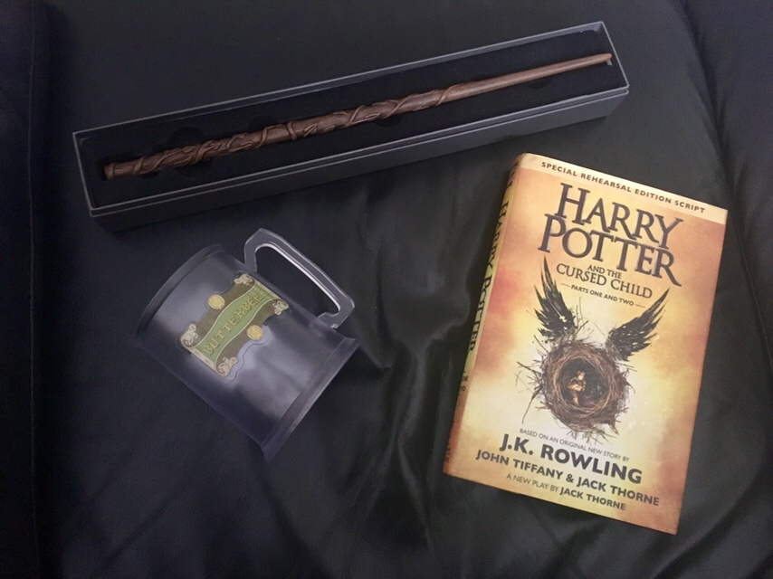 Harry Potter souvenirs - Butterbeer cup, Harry Potter and the Cursed Child book, and Hermione's Wand